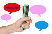 Hand holding crayons posts — Stockfoto