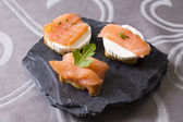 Delicious salmon canapes — Stock Photo