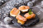 Delicious salmon canapes — Stock Photo