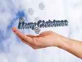 Hand met kerstversiering — Stockfoto