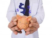 Businessman with piggy bank in hands — Stock Photo