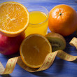 Orange juice with fruit and tape measure — Stock Photo #63552625