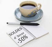 Cup of coffee with writing book sales — Stock Photo