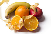 Fruits with measuring tape isolated — Stock Photo