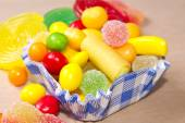 Assorted goodies with color background — Stock Photo