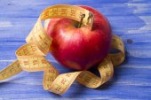 Fruit and tape measure with background — Stock fotografie