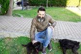 Bearded man with dog — Stockfoto