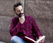 Bearded man with book — Stock fotografie