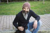 Bearded man with dog — Stock Photo