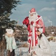 Father Frost and the Snow Maiden with gifts 1457. — Stock Photo #60667027