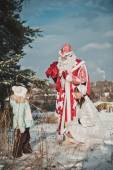 Father Frost and the Snow Maiden with gifts 1457. — Stock Photo