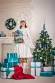The girl in the New Years dress with gifts 1508. — Stock Photo