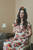 The pregnant girl in a dress 2127. — Stock Photo
