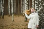 The young girl costs about a tree a birch 2639. — Stock Photo