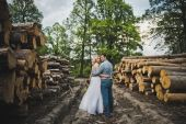 The guy and the girl walk among fire wood 3232. — Stock Photo
