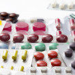Color tablets, capsules and vitamins in blisters on the white background — Stock Photo #67766341