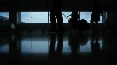 Silhouettes of people with bags in airport — Stock Video