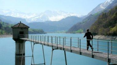Businessman walking across the bridge — Stock Video