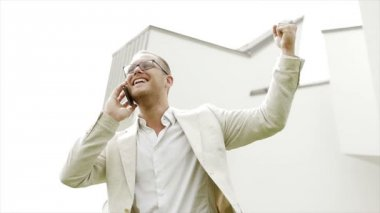 Happy caucasian businessman enjoying positive business conversation on the phone — Stock Video