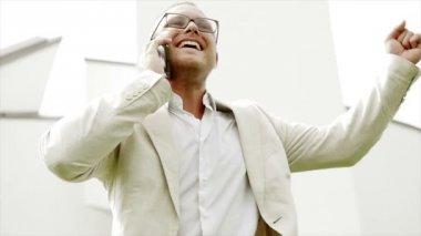 Happy caucasian businessman enjoying positive business conversation on the phone — Stock Video