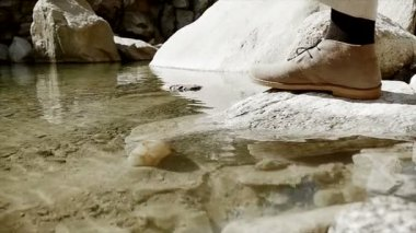 Man taking stone out of water — Stock Video