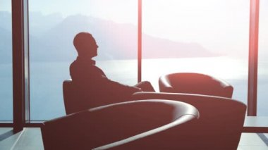 Silhouette of young businessman sitting on the chair — Stock Video