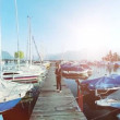 Young businessman standing among the yachts and boats in the marina — Stock Video #60426853