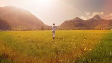 Man running on grass field — Stock Video