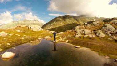 Man raising hands over the lake — Stock Video