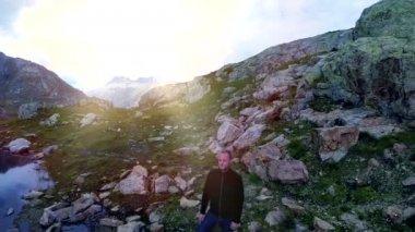 Man standing on rock in mountain lake — Stock Video