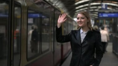 Woman waving with her hand to the departing  train — Stock Video