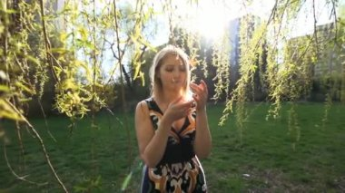 Woman touching tree branch with leaves — Stock Video