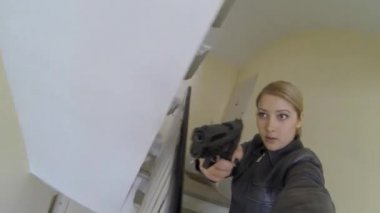 Woman with gun on stairs — Stock Video