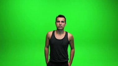 Man standing against green screen — Stok video