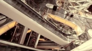 People on moving escalator — Stockvideo