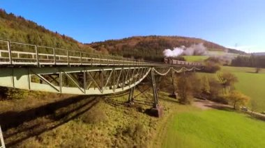 Locomotive crossing bridge — Stock Video