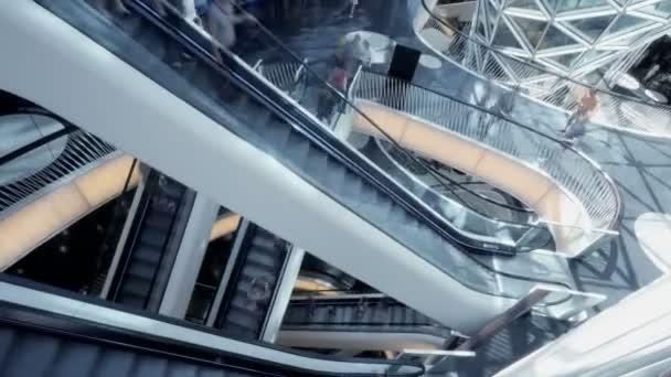 People moving on modern escalator — Vidéo