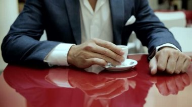 Businessman drinking coffee — Stock video