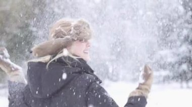 Woman enjoying snowfall — Stock Video