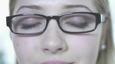 Woman in glasses open eyes — Vidéo