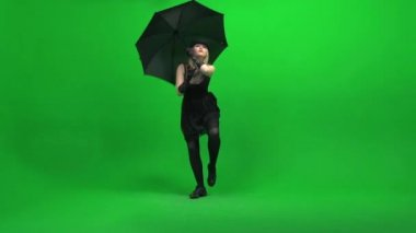 Woman dancing with umbrella — Stock Video