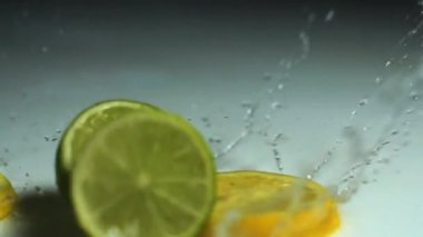 Lemon mix splashing in water — Stock Video