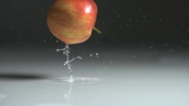 Apple dropping on water — Stock Video