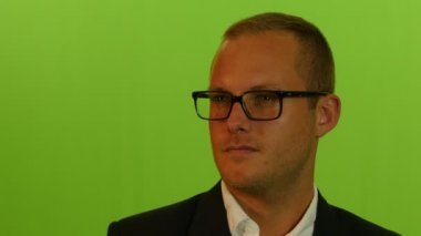 Portrait of businessman in glasses — Stock Video