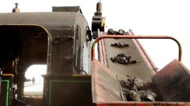 Shoveling charcoal for steam — Stock Video