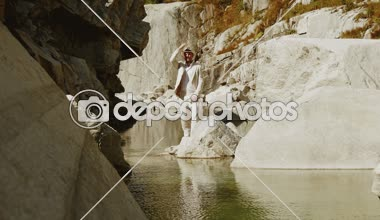 Man standing in canyon river — Stock Video