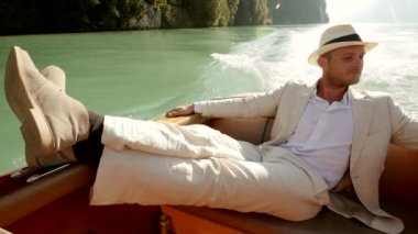 Young man enjoying boat ride — Stock Video