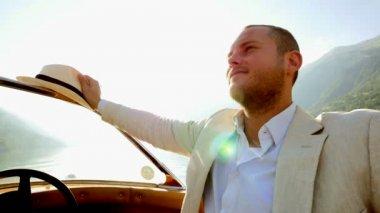 Carefree man enjoying boat ride — Stock Video