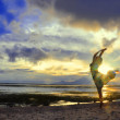 Woman dance at the Sunset over Bali as seen from Gilli — Stock Photo #64181109