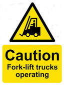 Caution Fork-lift trucks operating sign — Stock Photo